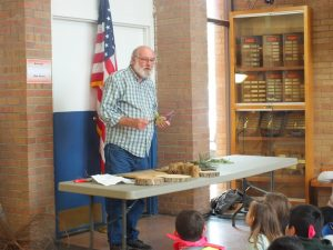 Jim Strine, retired forester with he Kansas Forest service lends a hand to teach students about trees.
