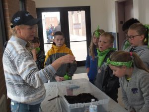 Tanya Allemang, Logan County NRCS teaches the students how worms help the soil.